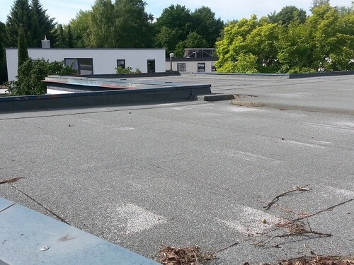 Flat rolled roofing can also be used on residential homes