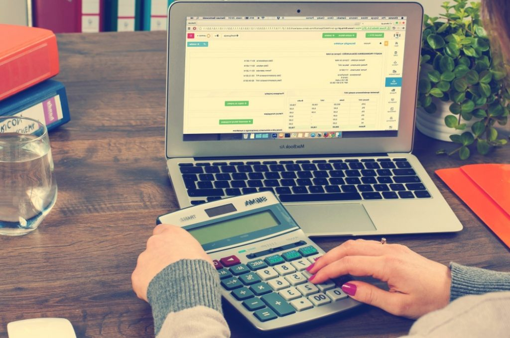 woman calculating personal loan